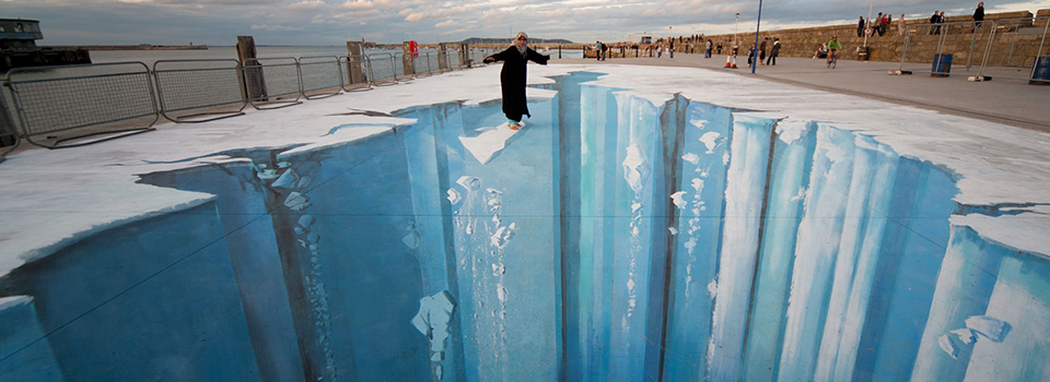Woman balancing on glacier illusion