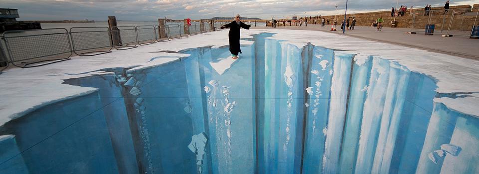 Woman balancing on glacier illusion